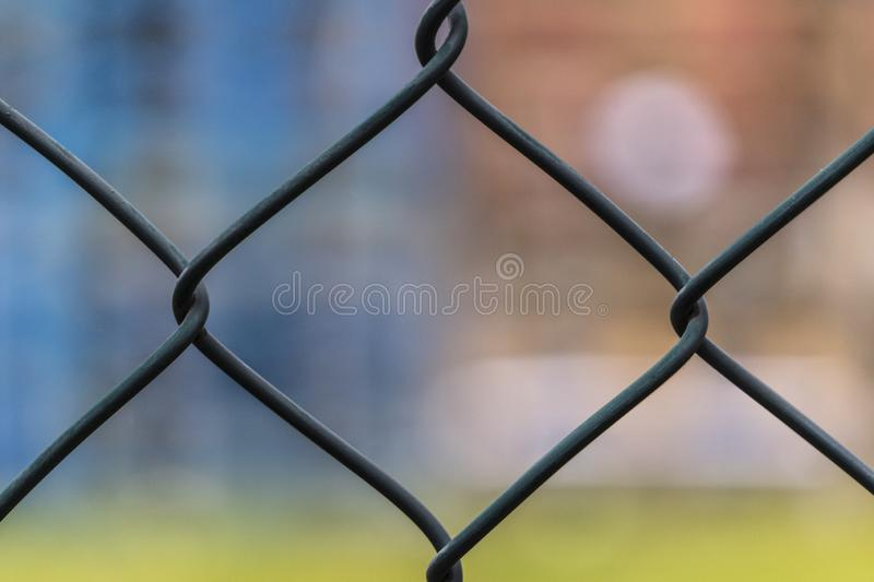 Metal fence netting, netting on a blurred background. Large metal mesh. Close-Up View Of Wire Fence. Metal fence netting, netting on a blurred background. Large royalty free stock image