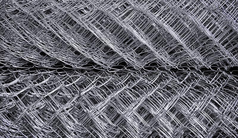 Metal grid. Multi-layer mesh. Construction Materials. Mesh netting. Selective focus. Close up stock image