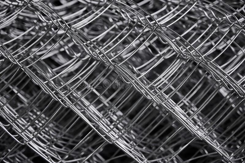 Metal grid. Multi-layer mesh. Construction Materials. Mesh netting. Selective focus. Close up royalty free stock photo
