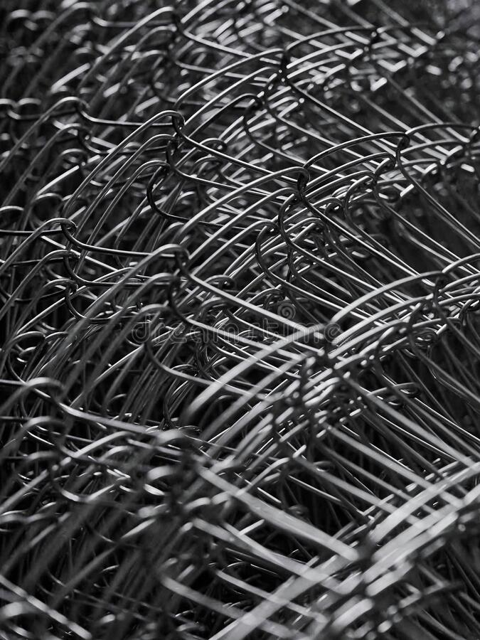Metal grid. Multi-layer mesh. Construction Materials. Mesh netting. Selective focus. Close up stock photography