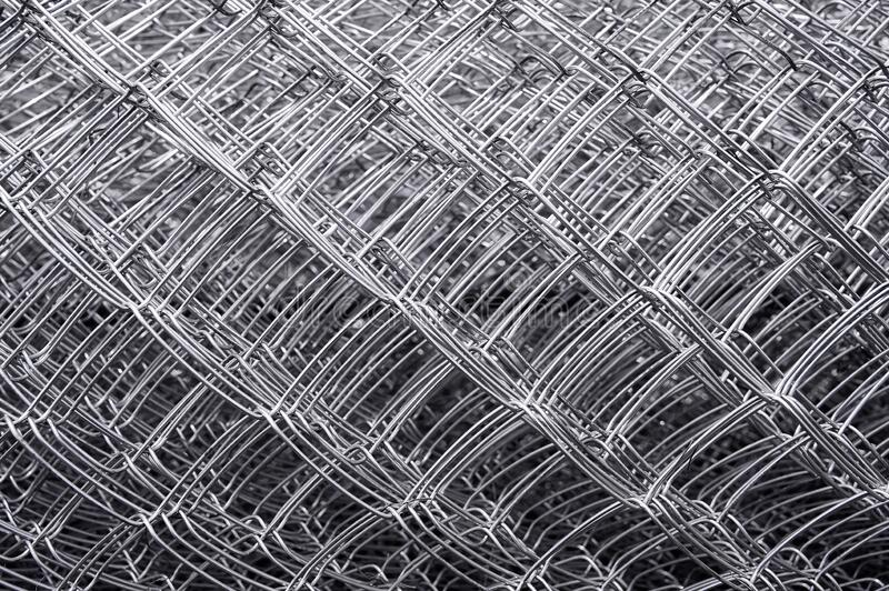 Metal grid. Multi-layer mesh. Construction Materials. Mesh netting. Selective focus. Close up stock photo