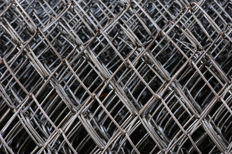 Metal netting mesh. In several layers, selective focus royalty free stock images