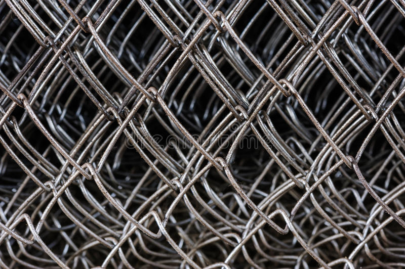 Metal netting mesh. In several layers, selective focus stock photos