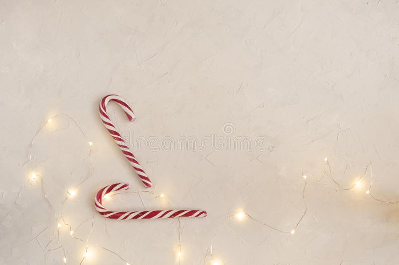 Minimal Christmas concept - Candy canes, white background royalty free stock photo