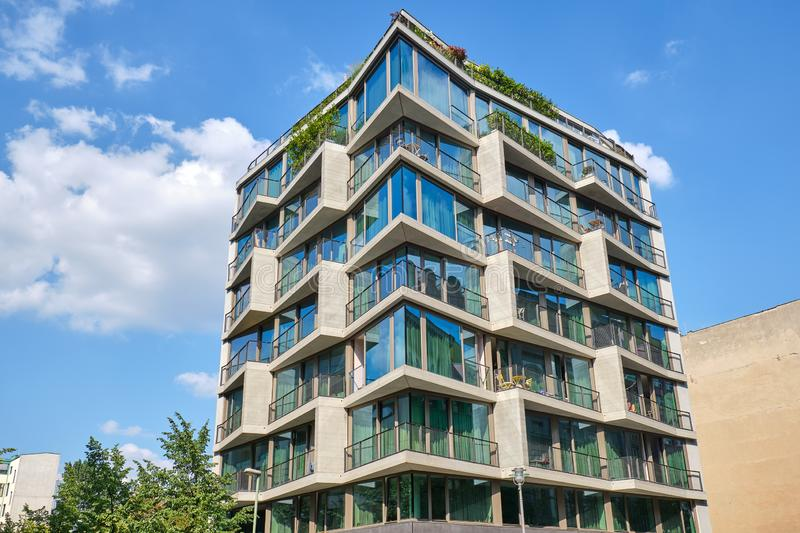 Modern apartment building with floor-to-ceiling windows. Seen in Berlin, Germany stock photography
