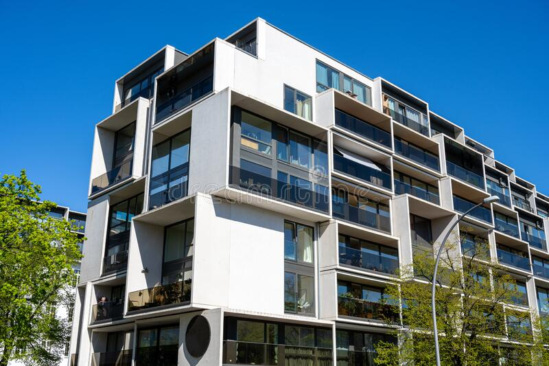 Modern apartment building with floor-to-ceiling windows. Seen in Berlin, Germany stock photos