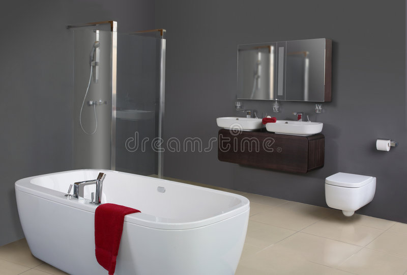 Modern Grey Bathroom. Including bathtub, shower, basins and toilet stock images