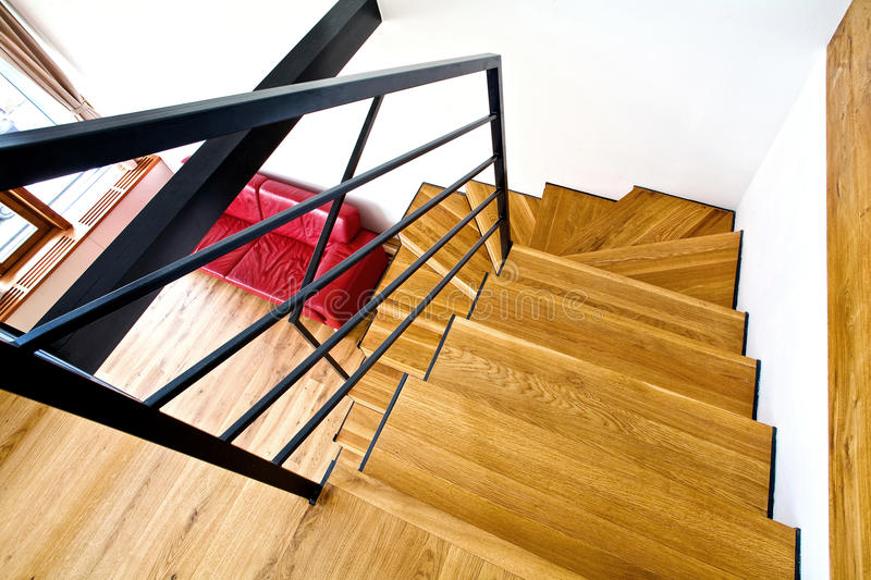 Modern house with stairs. And red sofa royalty free stock photos