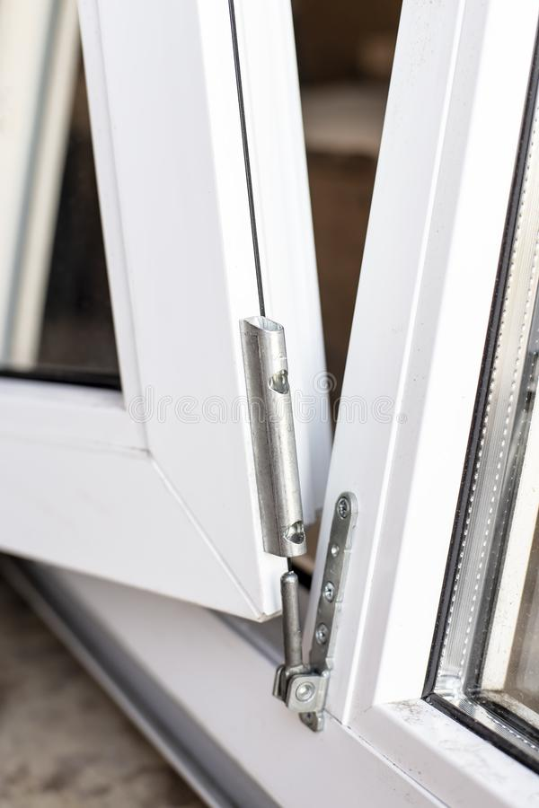 The movable part of the PVC window is connected to the frame usi stock photos