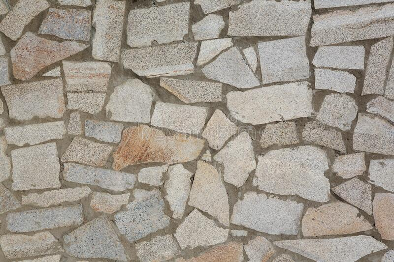 Natural texture and background. Wall of pieces of chipped stone granite. Natural texture and background. Wall of pieces of chipped stone slabs of gray granite stock image