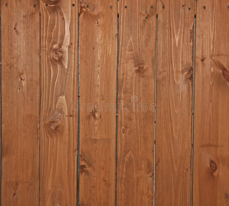 A wall of orange boards. Wood floor with a natural, natural structure. Natural, woody texture of boards. A wall of orange boards. Wood floor with a natural stock photography