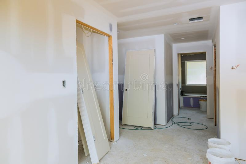 New home installing material for repairs in an apartment is under construction, remodeling, rebuilding and renovation door. New home installing material for stock photo