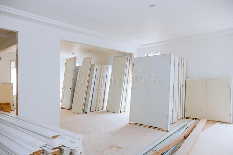 New home installing material for repairs in an apartment is under construction, remodeling, rebuilding and renovation door. New home installing material for royalty free stock image