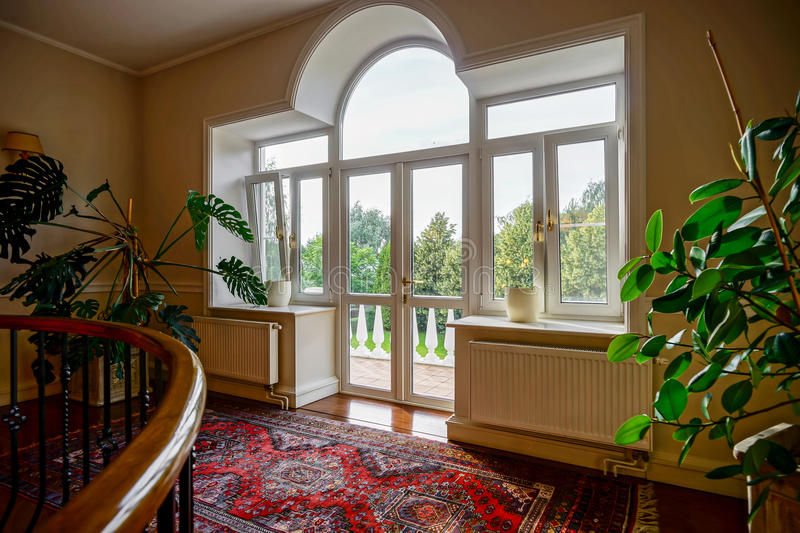 New pvc windows in old-styled interior stock images