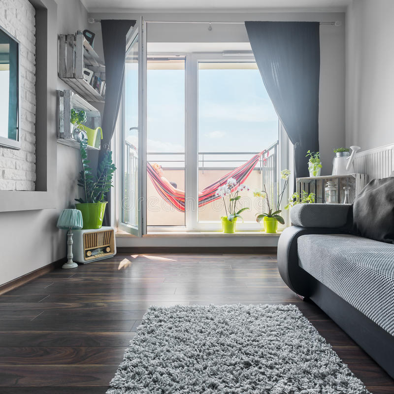 Nice living room with big windows stock image