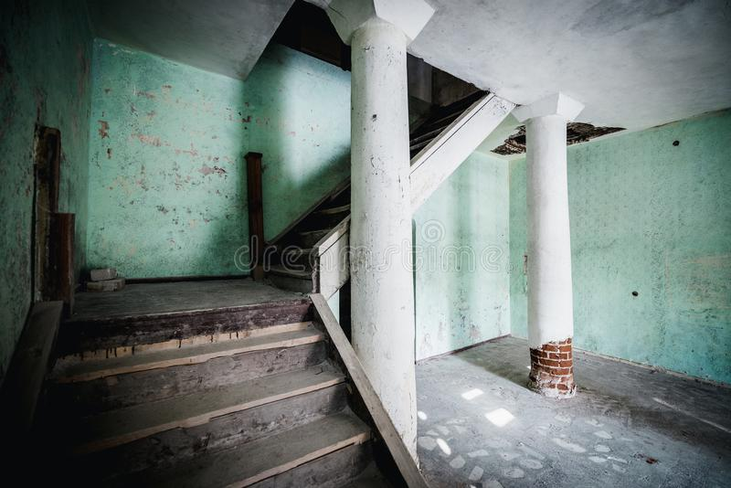 Old abandoned creepy manor house room. Stairs to the second floor. Šumskas Manor is a former residential manor in Šumskas, Vilnius District Municipality stock photography