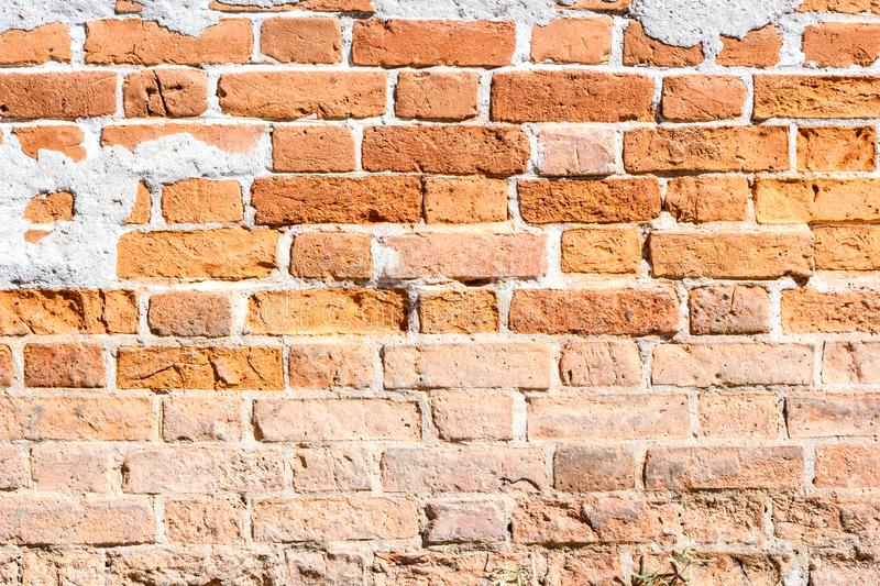Old brick wall pattern red color of modern style design decorative uneven .Loft  style design ideas living home stock photography