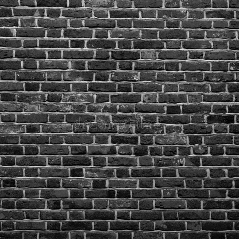 Old Grunge Black and White Brick Wall Background. Abstract Brickwall Texture Close up. Monochrome Background. Square Wallpaper or royalty free stock image