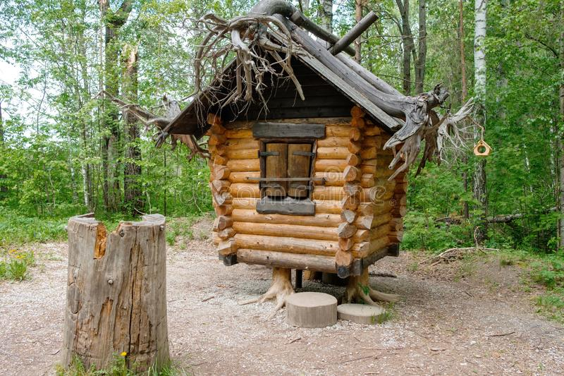 Old hut from Russian fairy tales in the woods in the summer. In a clearing in the forest mystical house stock photography