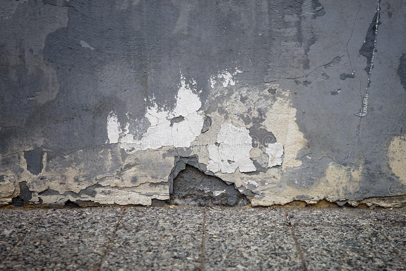 Old painted wall with crumbling plaster stock photos