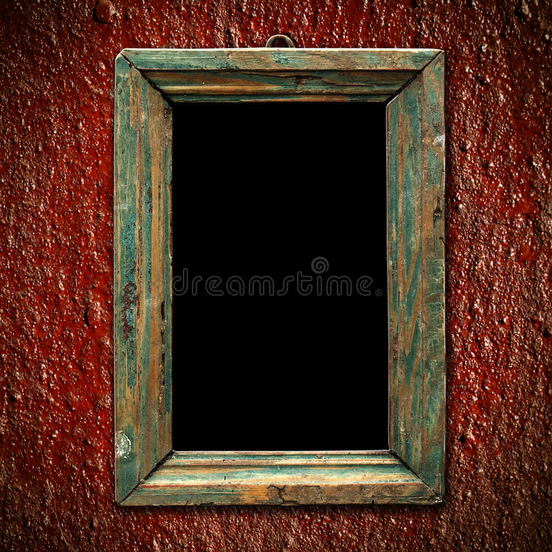 Old picture frame. An old picture frame on the red wall Vintage background stock illustration