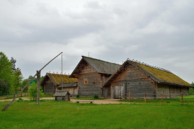 Old Russian log hut in Pushkin Mikhailovskoe. Summer cloudy day stock photography