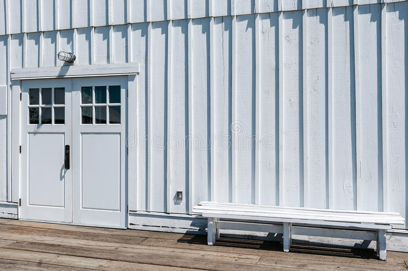 White Clapboard Building. An old white clapboard building, newly painted stock photography