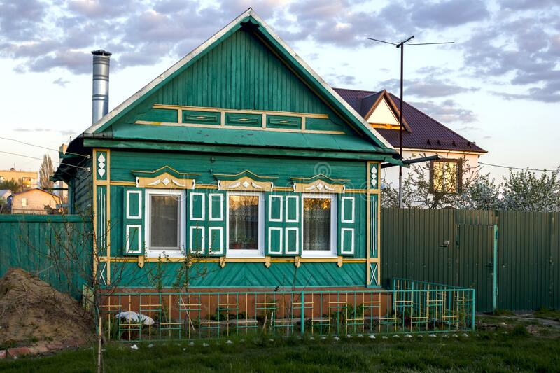 Old wooden house in a Russian village with carved windows and shutters royalty free stock images