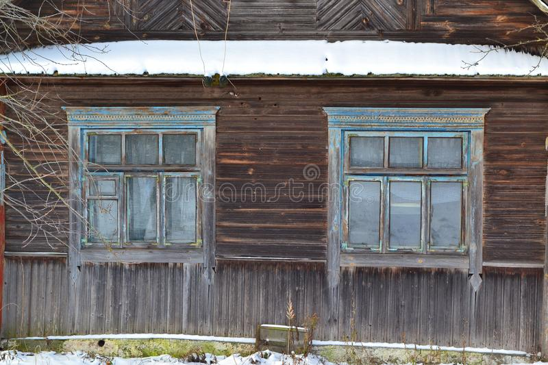 An old wooden window in russian style on a log wall. Traditional old house stock photos
