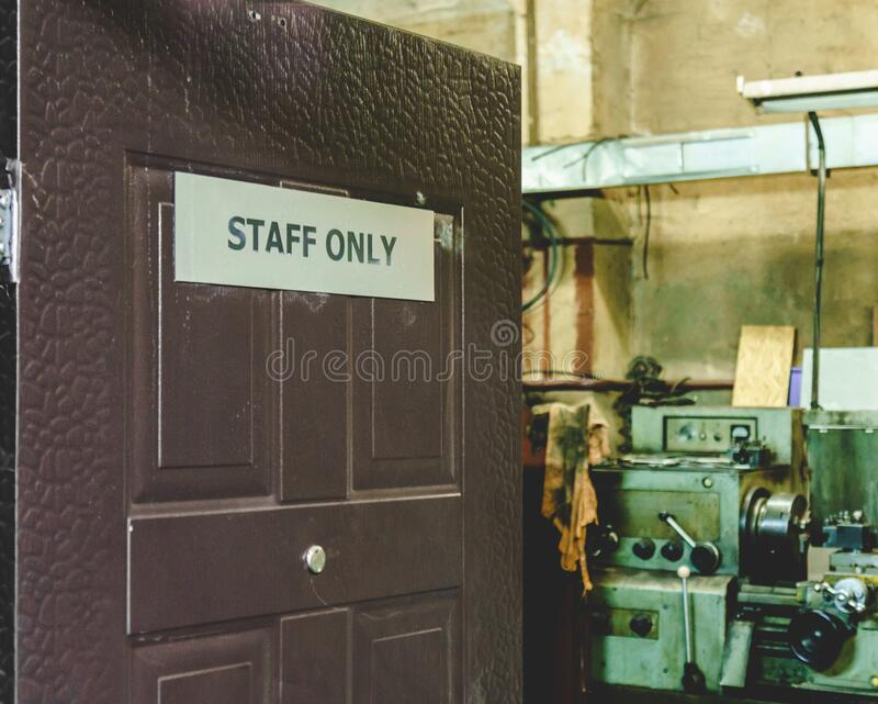 Open door with sign staff only to car repair shop room royalty free stock photography