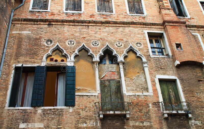 Ornate windows in Venice on an old house. Italy, Europe stock images