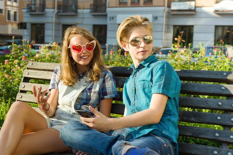 Outdoor portrait of a teenage boy and girl 14, 15 years old. Outdoor portrait of a teenage boy and girl 14, 15 years old stock photography