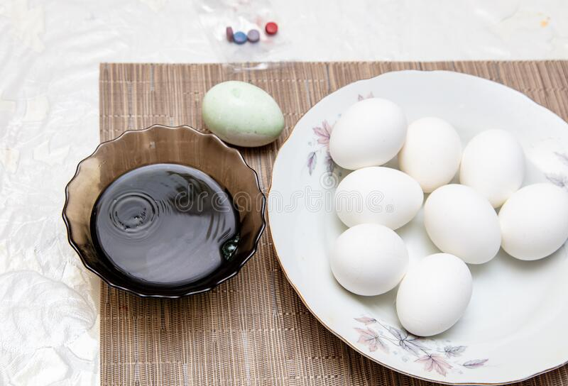 Painting eggs in the kitchen. Orthodox Easter holiday royalty free stock photos