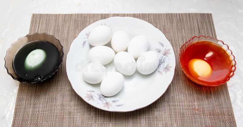 Painting eggs in the kitchen. Orthodox Easter holiday royalty free stock photo