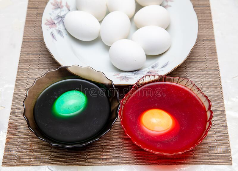 Painting eggs in the kitchen. Orthodox Easter holiday stock photos