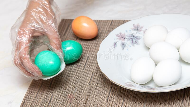 Painting eggs in the kitchen. Orthodox Easter holiday royalty free stock images