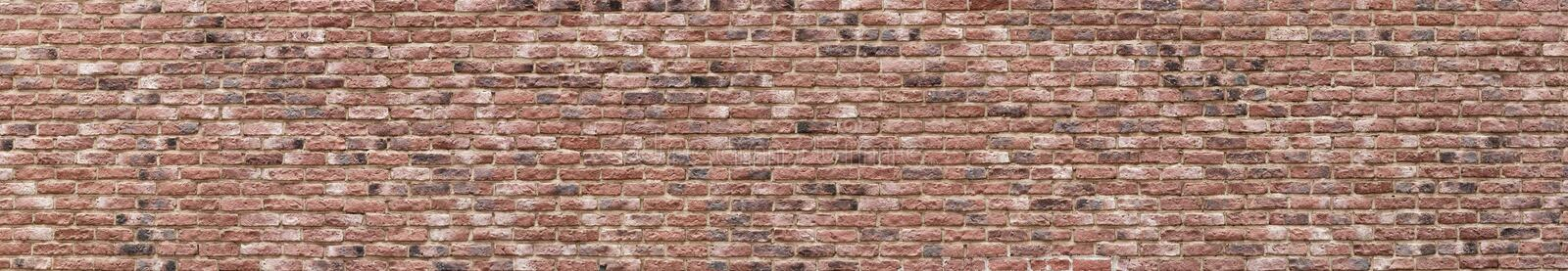 Panoramic high resolution vintage pink, black and red brick wall background texture. Architecture grunge detail abstract theme. Home, office or loft design stock photo