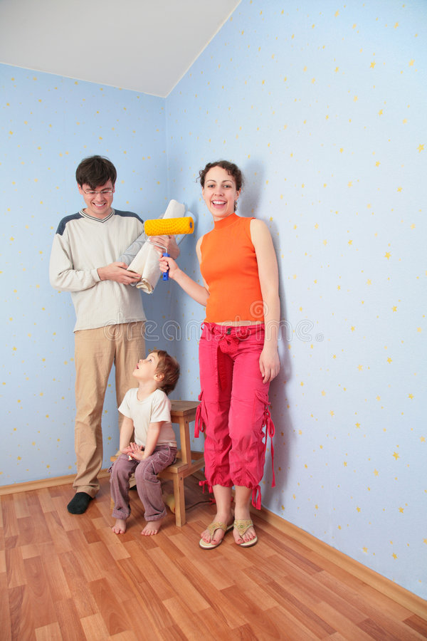 Parents with daughter in room after repair. Parents with daughter in the room after repair stock images