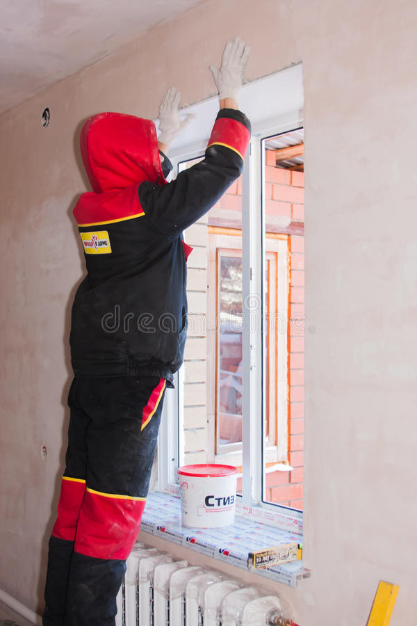 PERM, RUSSIA, NOVEMBER 19.2015:Installation of plastic window royalty free stock images