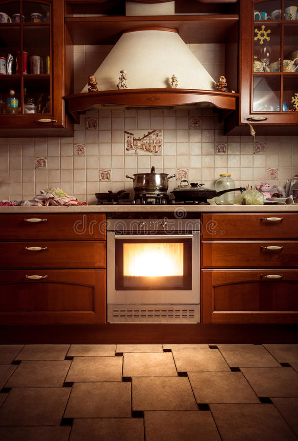 Photo of country style kitchen with hot oven. Interior photo of country style kitchen with hot oven stock image