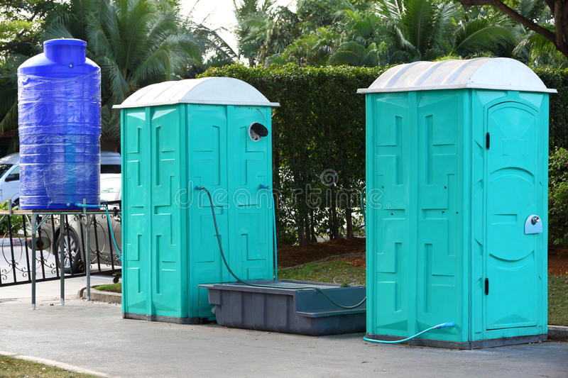 Portable toilet. Green color Portable toilet with blue color water tank ready to service people for outdoor event royalty free stock images
