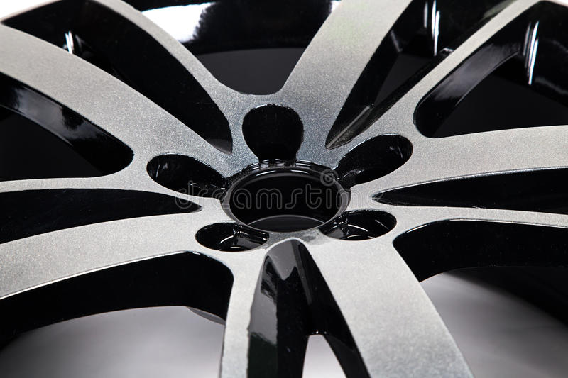 Powder coating of black wheel disk royalty free stock image