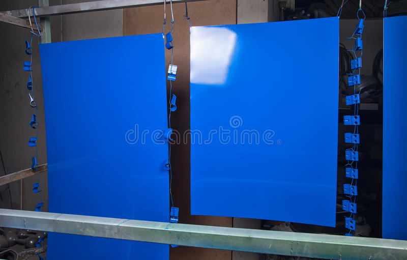 Powder coating and drying of blue details. In workshop royalty free stock image