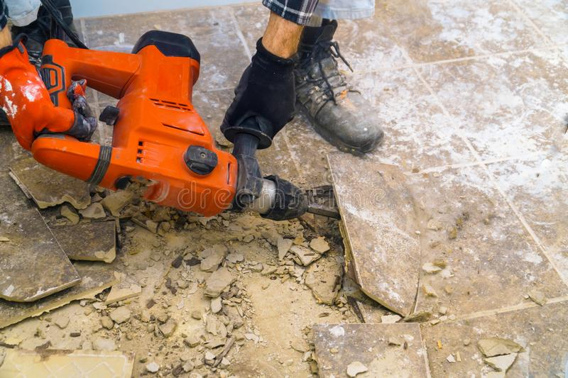 Preparation of repair the bathroom. Removing old tiles. With jackhammer renovation demolition house construction concrete interior work home demolish tool royalty free stock image