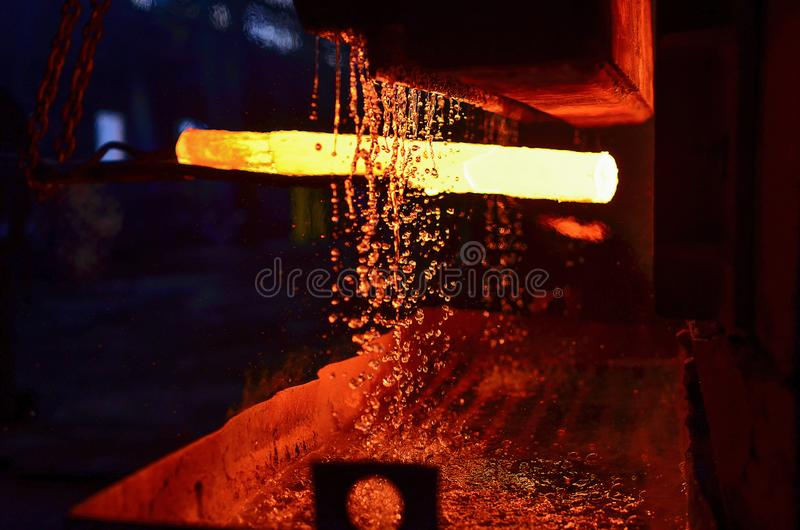 The process of forging metal in the production of heavy molded metal products. Blacksmithing. Pattern and forms for the artist blacksmith. Treatment of molten stock images