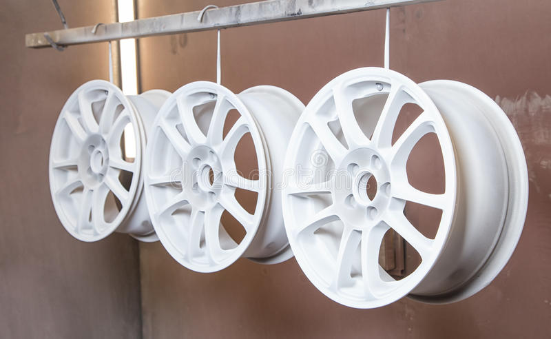 Process of powder coating auto wheels stock photo