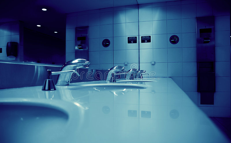 Public toilet room. Clean sterile airport public toilet room with taps royalty free stock image