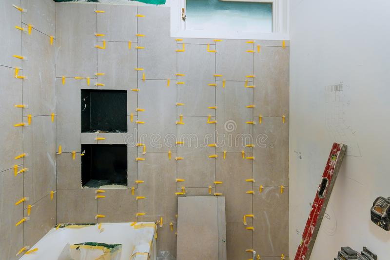 Renovation construction laying floor and wall tile reconstruction of bathroom royalty free stock photography