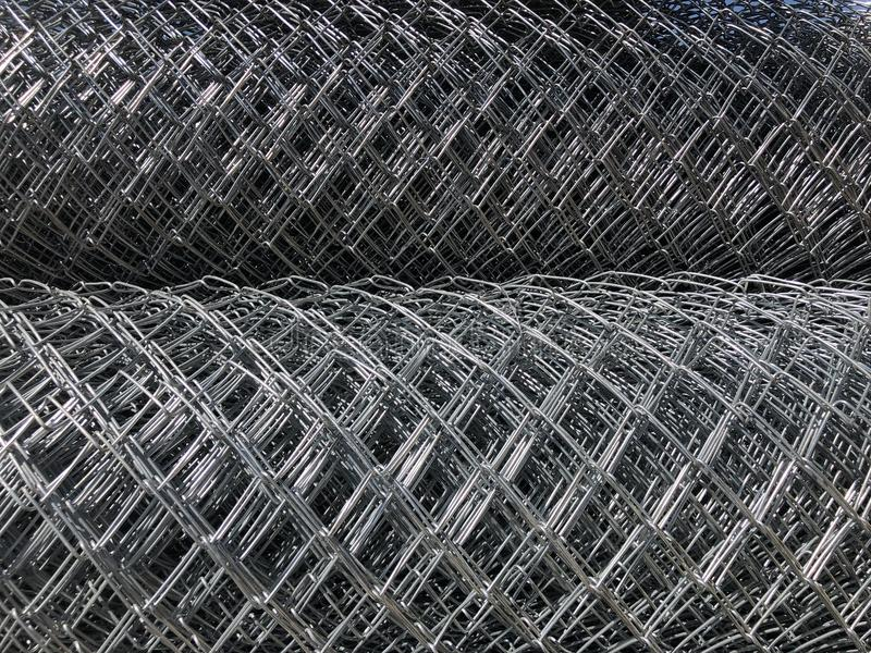 Rolled chain-link fence. Metal mesh netting rolled into rolls.  stock photography