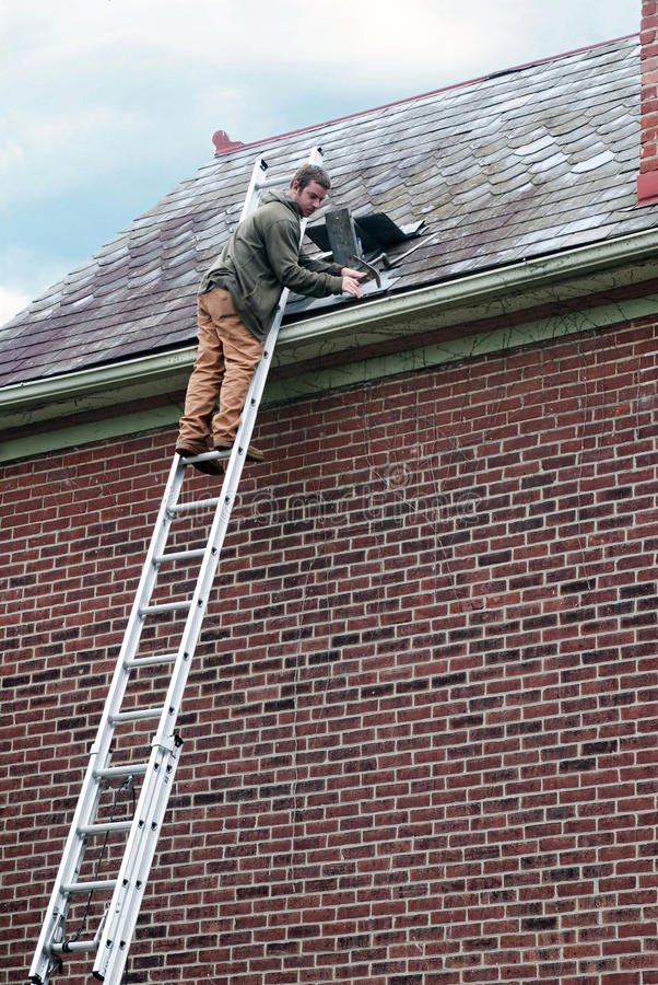 Roof Worker on Ladder stock photos